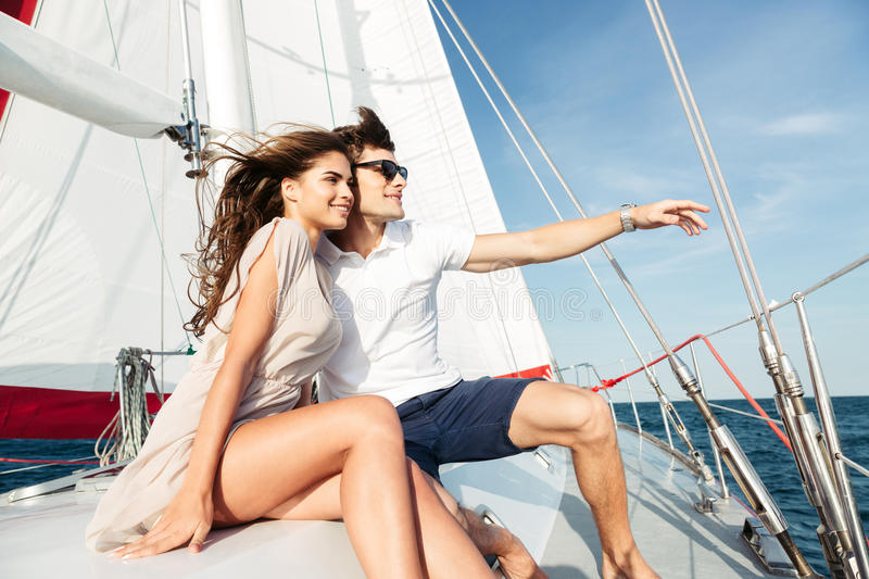 young-beautiful-married-couple-embracing-yacht-vacation-77720289